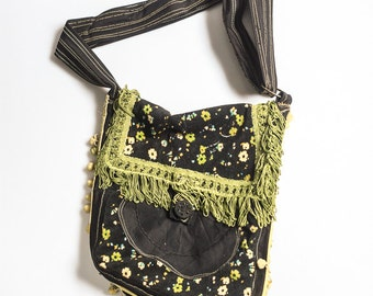 black and floral fabric messanger bag with green fringes