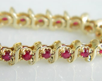 Beautiful Ruby 14K Gold Classic Tennis Bracelet