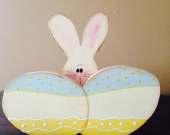 Bunny hidding behind two easter eggs. Can be personalized free.