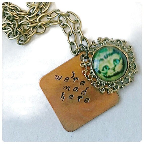 in necklace mad hatter by heavyistheheart
