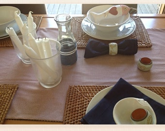 Red, white and blue! Reversible cotton table runner in vintage red gingham and blue star print.