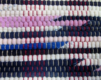 pink, blue and black handwoven rag rug made from recycled t-shirts