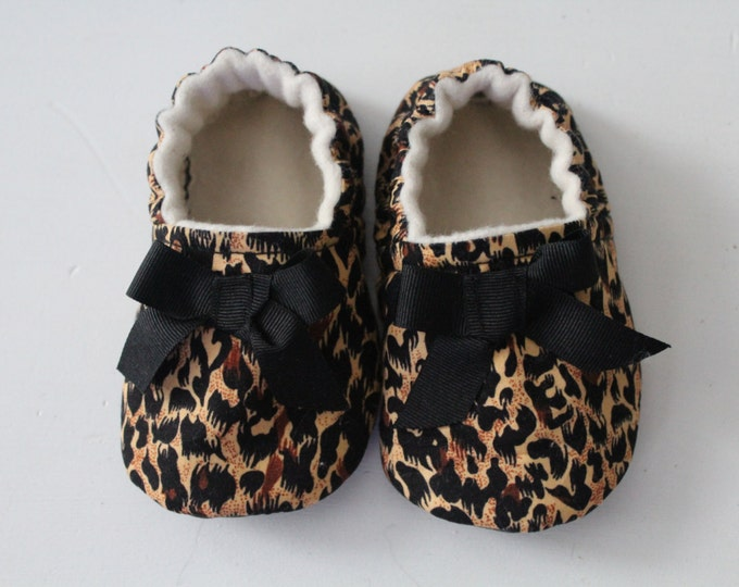 leopard print cotton soft sole shoe with black satin bow detail
