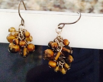 Brown bead earrings. Bead earrings. Dangle earrings. Brown dangle earrings. Brown earrings. Bead jewelry. Brown. cluster of beads. TBFB0680