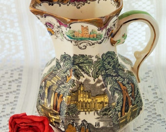 A rare and stunning antique hand embellished Mason's jug/pitcher in the romantic 'Vista' design, Leeds series. Very collectible. c.1930s.