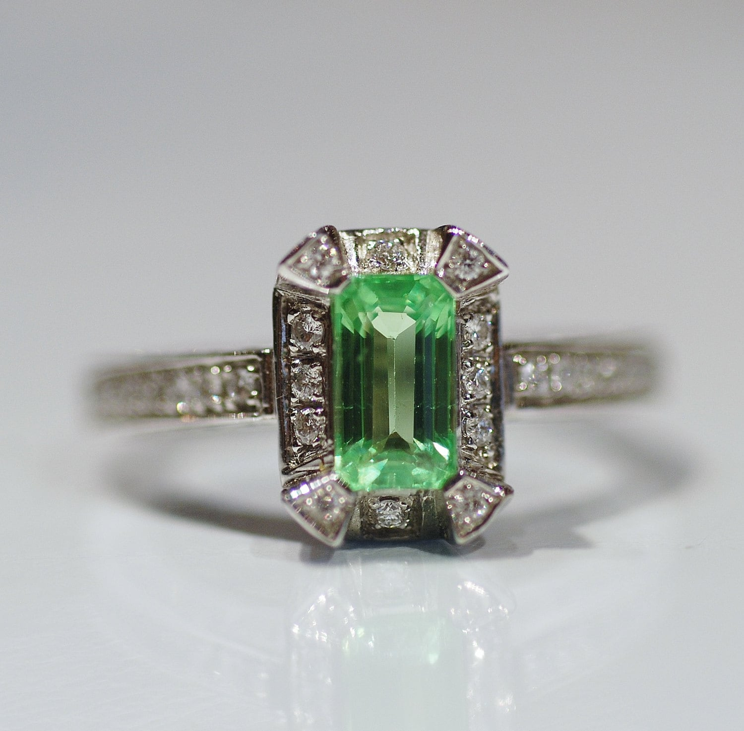 emerald cut green garnet and ring in white
