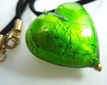 A lime green large Murano glass heart pendant on black suede cord.