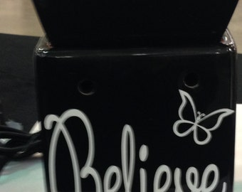 Believe tart warmer. Comes with two free soywax tarts.  Lid is removable so removing wax is so simple.