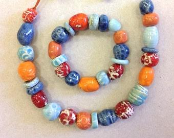 Ceramic necklace ,Porcelain necklace ,Blue, Orange,Made to order