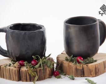 Black pottery mug