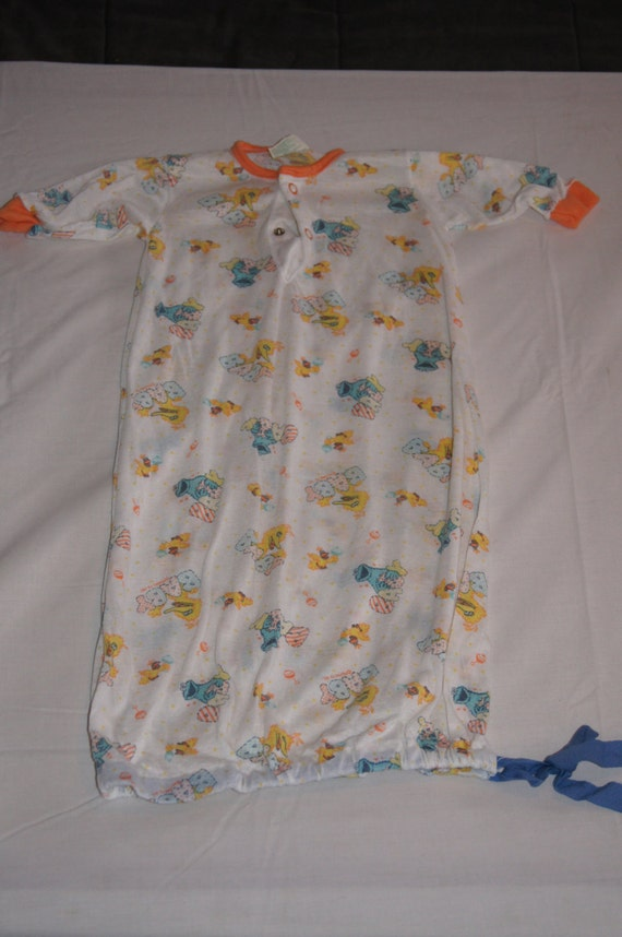 hold Vintage 1980 s JCPenney Baby esie with Sesame