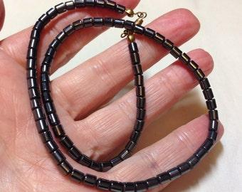 Strand of Hemitite Drum Beads (Approx 5mm x 4mm) (88 beads)