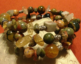 Multi-strand memory wire stone bracelet in soft, neutral colors.  Easy to wear, hand-crafted with natural materials.
