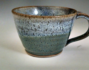 Speckled blue much with oatmeal rim