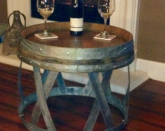 Wine barrel table 20 inches tall 23 1/2 inches wide. I have 2 that are a natural finish.