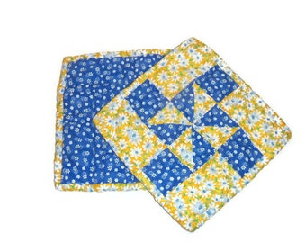 Quilted pot holder in blue and yellow floral cotton print fabrics