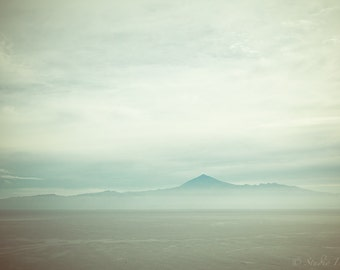 El Teide volcano in the mist, Tenerife. Landscape seen from the island La Gomera