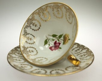 cup collects leaving saucer gold pattern