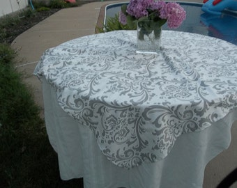 White aand gray damak table overlay