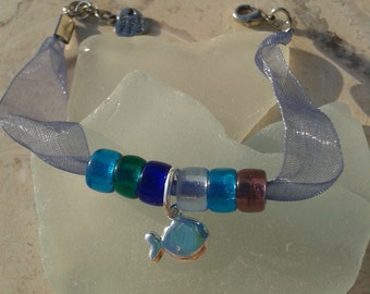 Sea and Silk – sea colored glass bead bracelet with fish and heart charms