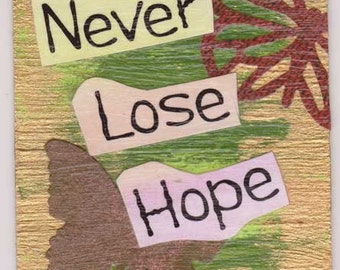 ACEO -- Never Lose Hope 1.  This is a mixed media, collaged trading card.