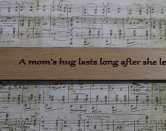 Oak Bookmark: A moms hug lasts long after she has let go - Author Unknown