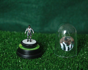 Faustino Asprilla (Newcastle Utd) - Hand-painted Subbuteo figure housed in plastic dome.