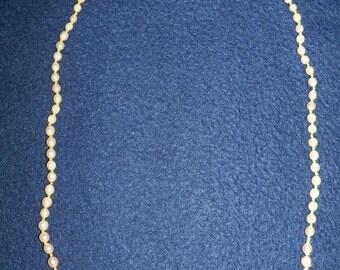 Collana perle coltivate a gradazione con chiusura oro 750 (18k) con spola corallo pelle angelo prima scelta mm.4,9x6,8