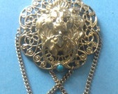 Lion head 1950-1970s vintage brooch with tiny turquoise stone
