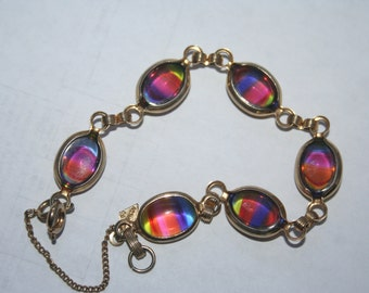 SELL OUT...  Vintage Gold tone  Rainbow Bracelet Marked Sarah Coventry