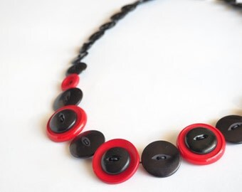 Red and black button necklace handmade with recycled buttons.