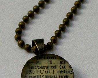 Spellbound -from vintage dictionary RECYCLED into a - long antiqued brass pendant necklace