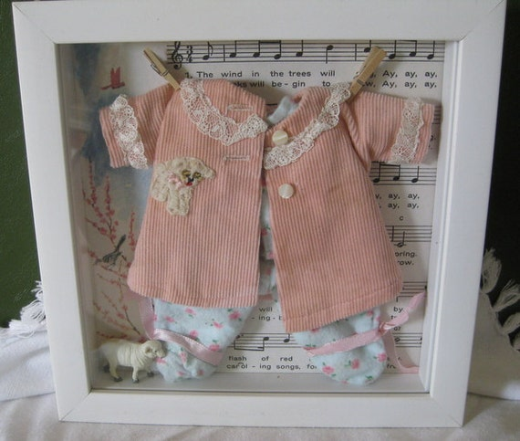 how to make a shadow box with baby clothes
