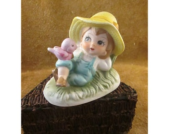 Daydreaming Little Girl in Straw Hat with Pink Bird – Vintage Ceramic Figurine
