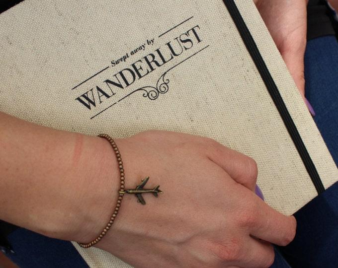 Wanderlust Bronze Travel Bracelet.