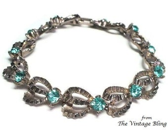50s Silver Ribbon Rhinestone Bracelet in Pave Set Aqua Blue Topaz Chaton Cut Crystals Textured Motif - Vintage 50's Costume Jewelry