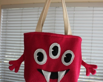 Three eyed pink monster bag