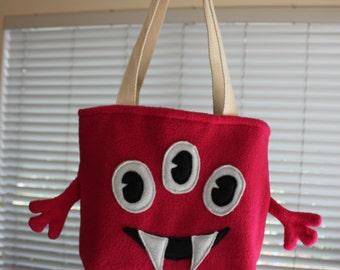 Three eyed pink monster bag