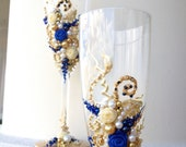 Hand decorated wedding champagne glasses, elegant toasting flutes in gold, ivory and royal blue. Beautiful toasting flutes, wedding gift