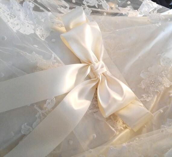 satin wedding dress with giant bow