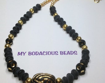 "Handmade 18"" NECKLACE  Matt Black and Gold  Focal Bead and Accents Golden Hook Closure"