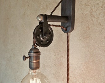 Industrial Pulley Sconce Lamp. Plug in. Instant ambiance.