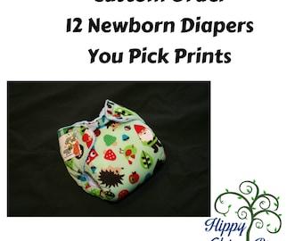 Twelve Newborn AI2 Diapers - You Pick Prints