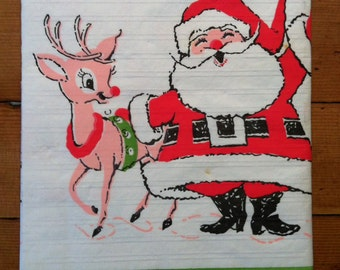 Vintage Paper table cloth with Santa Claus and Rudolf the red nose reindeer motif