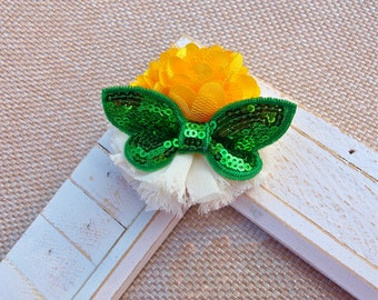 Shabby Chic White Flower Adorned with a Green Butterfly and Yellow Satin Flower