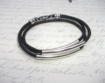 Wrap around black leather bracelet with silver tubes