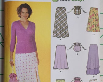 Simplicity 7090. Sizes 12, 14, 16, 18.  Misses' pull on bias skirts with length variations and purse. Pattern is uncut and factory folded.