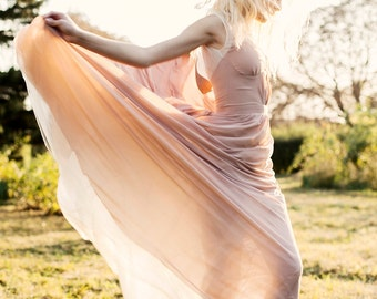 Beige sleeveless wedding dress with volant skirt