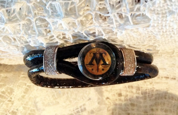 Harry Potter Bracelet Ministry of Magic Logo Brown Leather Bangle with Jeweled Gold Tone  Bands