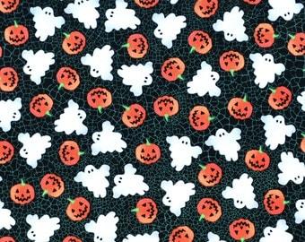 Ghosts and pumpkins dog bandana slides over the collar